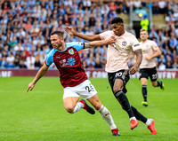 Marcus Rashford is held back by Phil Bardsley