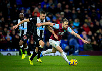 Ashley Barnes pushes past Paul Dummett